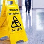 A slip hazard wet floor sign.