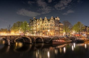 A bridge over the canal in Amsterdam at night.
