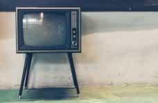 A retro television on legs.