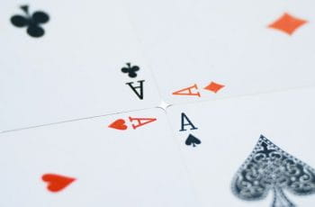 Four ace playing cards.