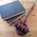 A gavel and some books.