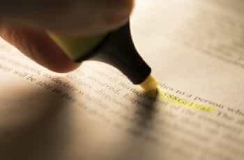 A person highlighting legislation.