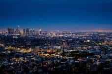The city skyline of Los Angeles illuminated at night.