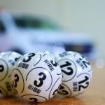 Black and white lottery bingo balls.