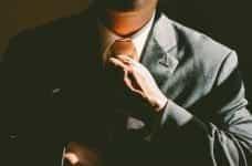 Man tying a tie.