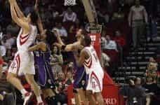 NBA Basketball player Yao Ming throws basketball in hoop.