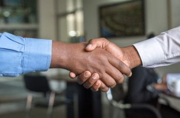 Shaking hands on a business deal.