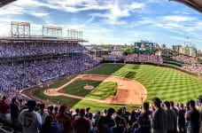Panorama of Wrigley Field during baseball game.