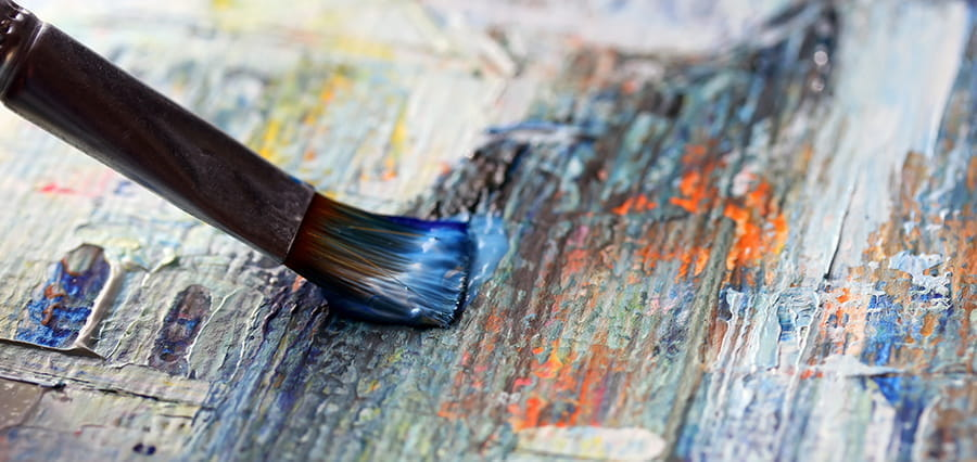 A paintbrush and paint.