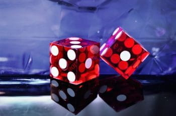 A pair of transparent red dice.