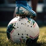 A football with a boot on top.