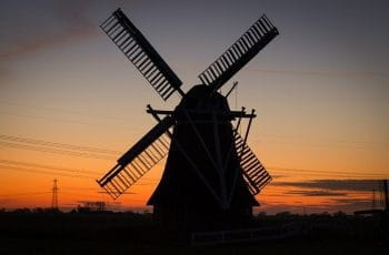 A windmill in Holland at sunset.