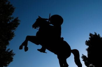 A silhouette of a monument featuring a man riding a horse in Mexico.