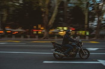 A man rides a motorcycle through the streets of Beograd, Serbia.
