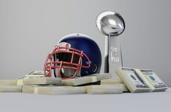 An NFL helmet sits atop stacks of cash beside trophy.
