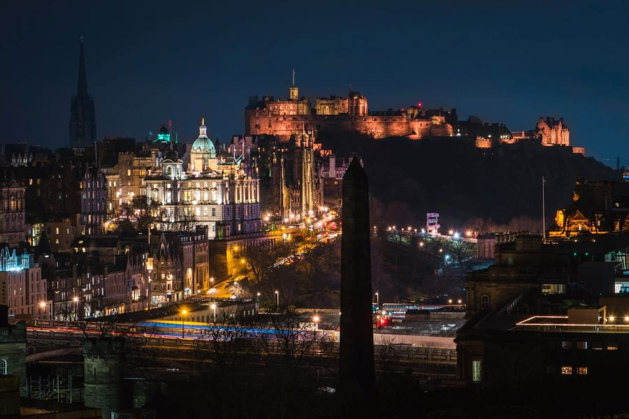 Edinburgh city lit up at night.