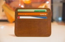 A small leather wallet containing bank cards.