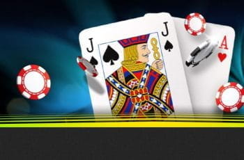 A Jack of Spades and an Ace of Hearts with casino chips.