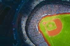 Baseball stadium at night from above.