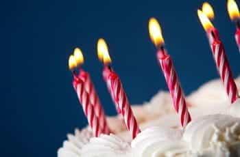 Candles atop a birthday cake.