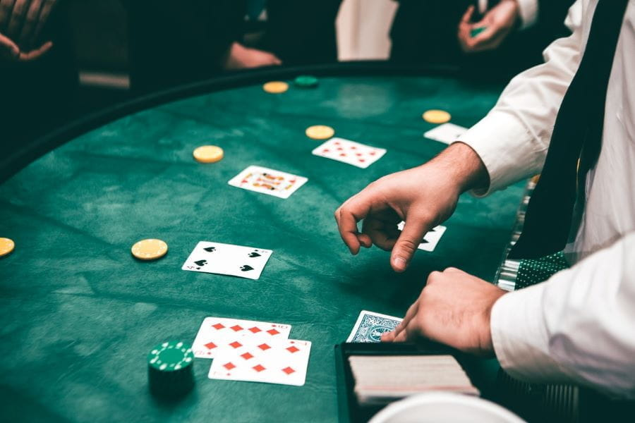 A croupier deals out cards at a casino.