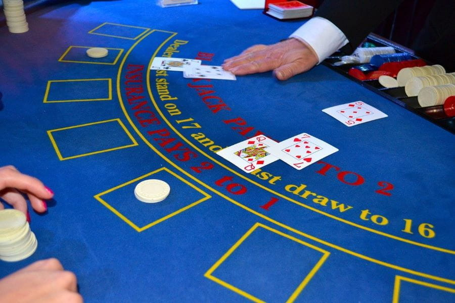 A casino croupier deals blackjack cards.