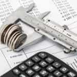 Balance sheet and coins.