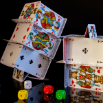 Stacks of cards next to multi-colored dice.