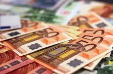A pile of Euro banknotes.