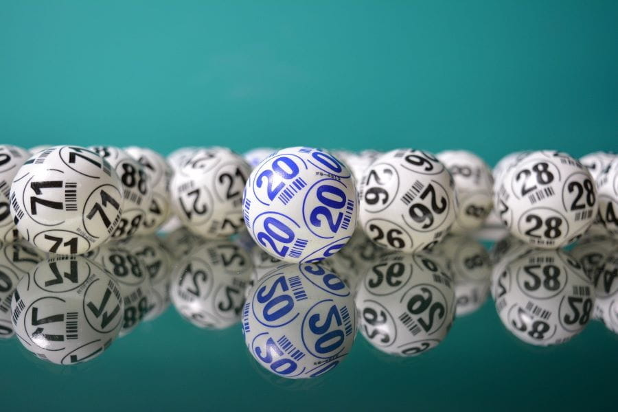 Numbered lottery balls on a blue background.