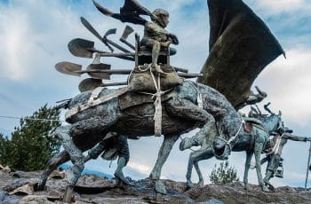 A monument of settlers on horseback in Manizales, Colombia.