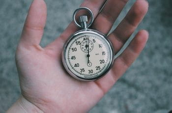 A stopwatch being held in a person's hand.