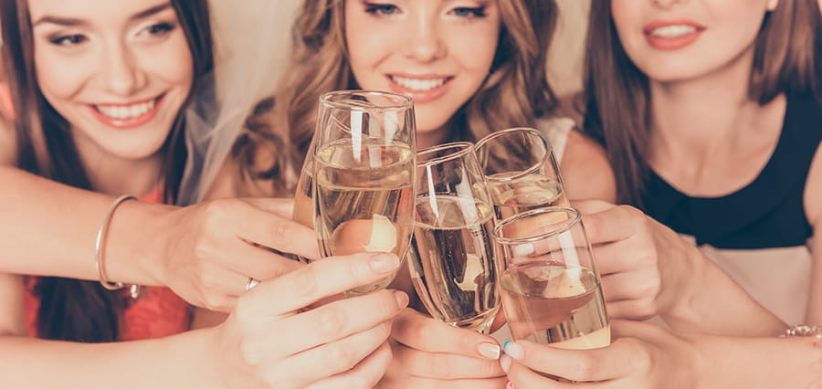 Women toasting with champagne.