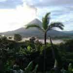 A volcano erupts over the jungle in Costa Rica.