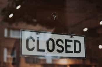 A closed sign in a shop door.