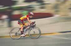 A man racing on a bike.