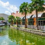 Chic businesses frame a canal in Cancún, Mexico.