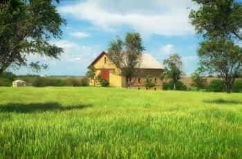 A farmhouse in a green meadow in Nebraska, USA.
