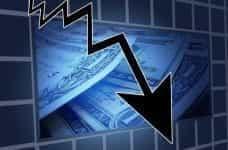 A downwards arrow representing a financial loss.