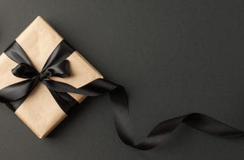 A present, wrapped in wrapping paper and ribbon.