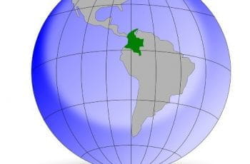 A graphic of the globe, with the country of Colombia shaded in Green.