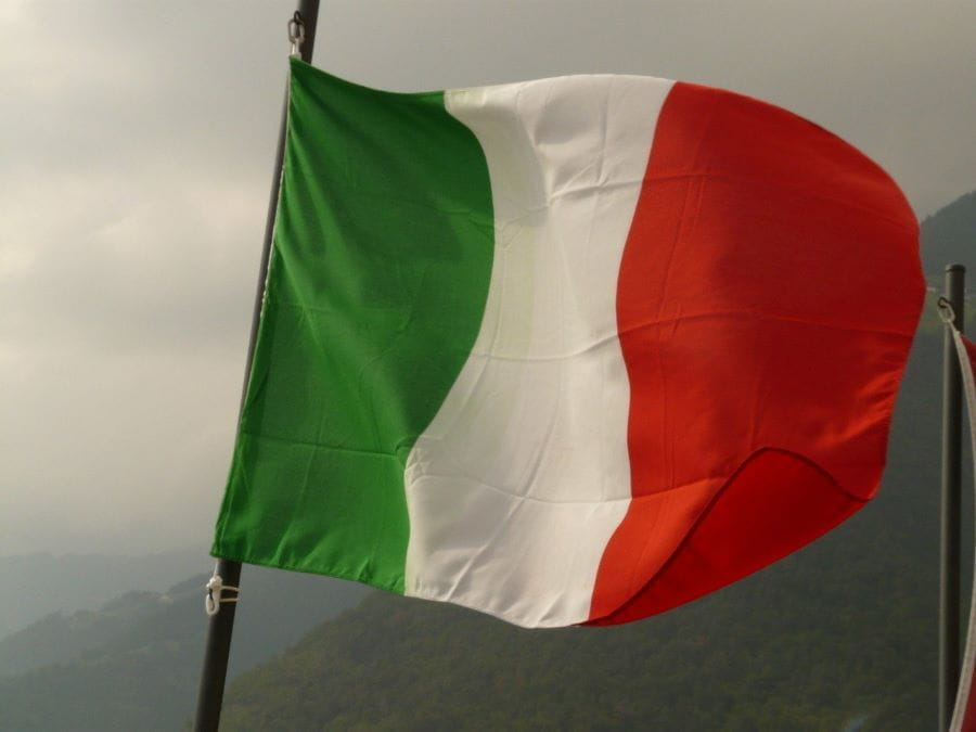 The flag of Italy flying from a flagpole.