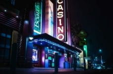 A neon casino sign at night.