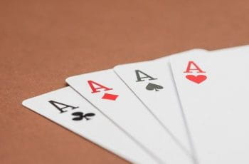 Playing cards that are four aces.