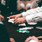 A dealer sets out cards on a poker table.