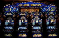 A brightly-lit row of slot machines in Las Vegas, Nevada.