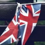 Union Jack flags on a bench.