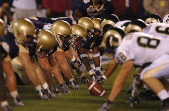 Two American football teams prepare for the next play.