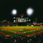 A packed baseball stadium in San Francisco, California at night.