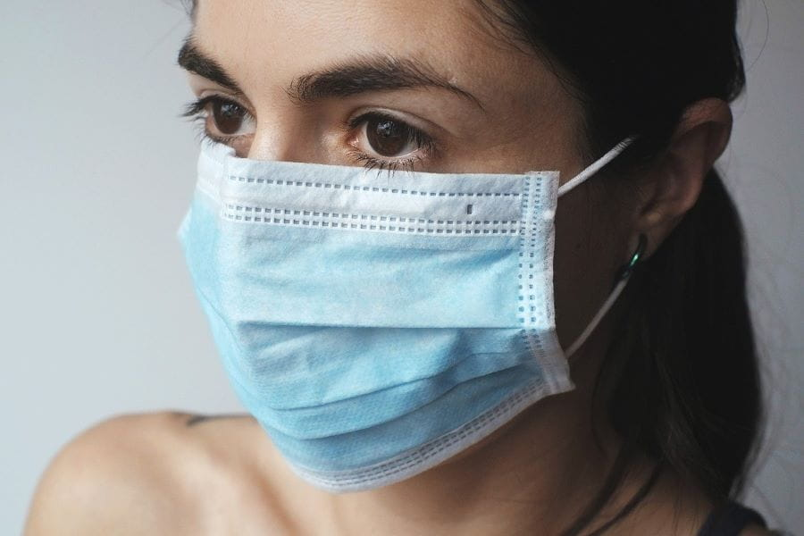 A woman wearing a facemask.